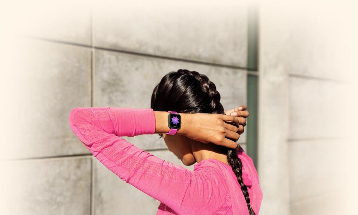 Zeblaze GTS Purple strap smartwatch on girl